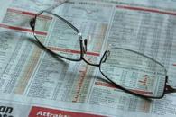 美股三大股指创历史新高 财报季或成雷区